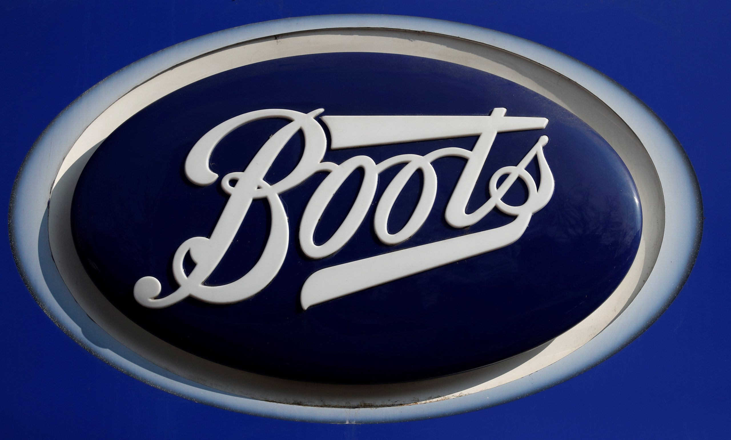 FILE PHOTO: A company logo is pictured outside a branch of Boots the chemists in Manchester northern England, March 17, 2016. REUTERS/Phil Noble/File Photo
