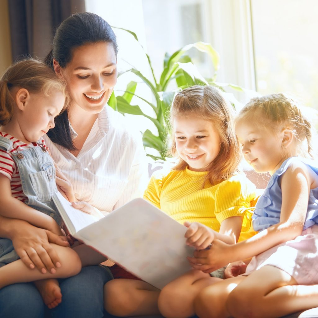 Mom and children reading a book